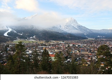 Top view of the city of Garmisch Partenkirchen and the snow-capped Alps mountains.