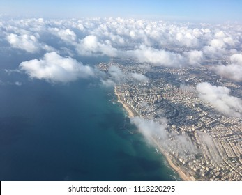 Top view of the city of Tel-Aviv and the Mediterranean Sea from the height of the aircraft.