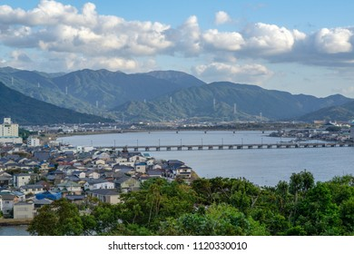 The top view Cityscape of Karatsu city from Karatsu Castle. Located by the sea with blue sky and clouds, Karatsu, Saga, Kyushu, Japan