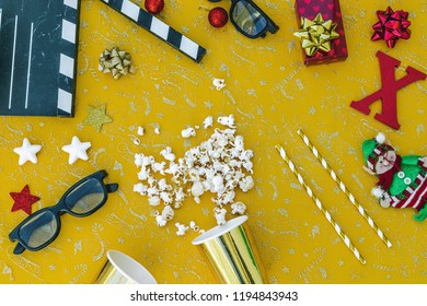 top view clapper board, pop corn 3d eyes glasses, gift, .Christmas items
