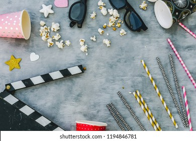 top view clapper board, vases, straw, 3d glasses, straws.Party cinema concept