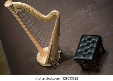 Top view of classical harp on the stage before the concert