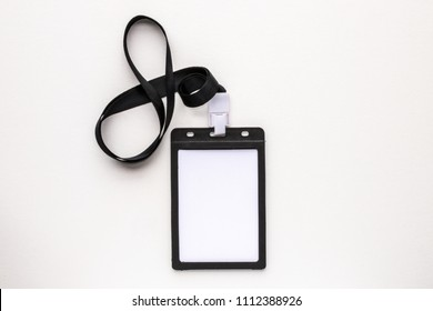 Top view close up of blank white badge name tag isolated on white background. Flat lay creative view. Business office background view.