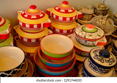 Top view close up of colorful earthen ceramic Porcelain crockery pots and soup bowls at a roadside market stall in India