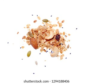 Top view close up photo image of granola pile isolated on white background, muesli grain texture, scattered seeds pattern, cereal food for good health.