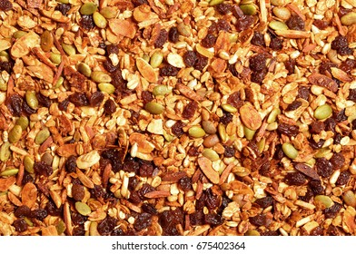 Top view close up photo image on muesli pile, abstract cereal grain pattern, granola texture as background, overlay for art work
