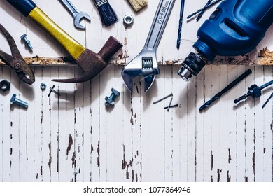 Top view close up of variety handy tools and rusty tools on grunge wood background with copy space for your text for Worker's day, Labor's day, labour's day background and DIY home fixing concept.