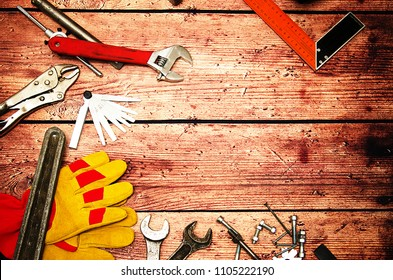 Top view close up of variety handy tools on wood background with copy space for your text for Worker's day, labour's day background