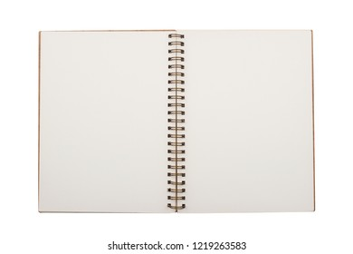 top view closeup of open notebook with copper metal spirals and brown hardcover blank pages isolated on white