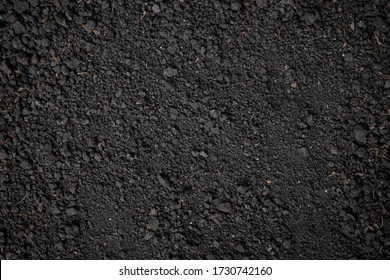 Top view, close-up of Organic black soil texture pattern background. Can be used planting tree. Surface has grunge and rough. Feature of compost fertile suitable for gardening and agriculture farm.