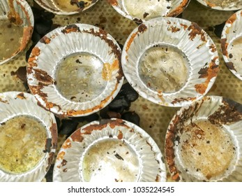 Top view and closeup used aluminium bakery cup made of cupcake.