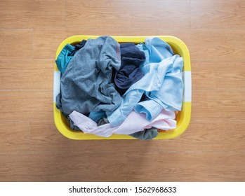 Top view Clothes in a laundry basket on floor.