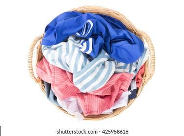 Top view Clothes on wicker baskets for washing preparations whit white background