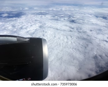The top view of clouds and sky from an airplane window