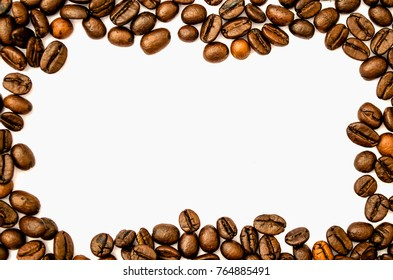 Top view of coffee beans on white background for frame.