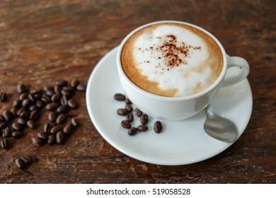 Top view coffee, cappuccino coffee and roasted coffee beans on wooden table