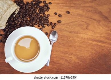 top view coffee cup and beans on wood background