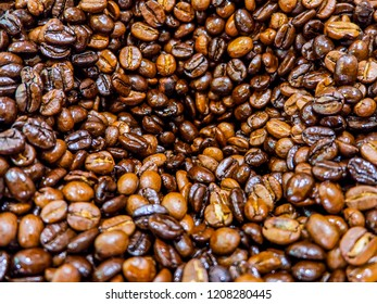 Top view of coffeebeans in blender machine.