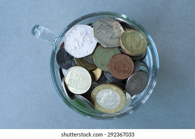 Top view of Coins in glass