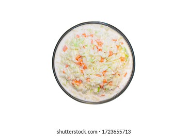 Top view of coleslaw salad in glass bowl on white background, isolated, clipping path included