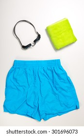 top view of collection of Swimming suit, caps and glasses