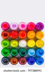 top view of color packed in clear bottles. Put together a rectangle on white background. Poster color for student range cheap price easy to paint for student. color are bold bright and opaque.