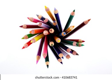 Top view of color pencils against white background