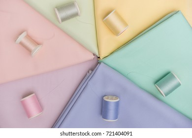 top view of color of thread on same color fabric for craft, flat lay style