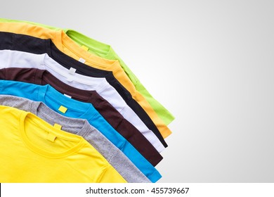 Top view of color T-Shirt isolated on grey background. Saved with clipping path