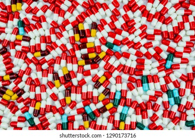 Top view colorful of antibiotic capsule pills background. Antibiotic drug resistance. Antibiotics drug use with reasonable and global healthcare concept. Pharmaceutical industry. Pharmacy products.