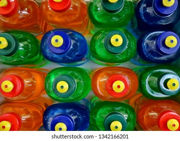 Top view of colorful dishwashing soap bottles on the supermarket shelf