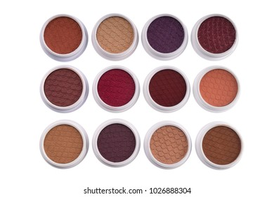 Top view of colorful eye shadows, isolated on white background