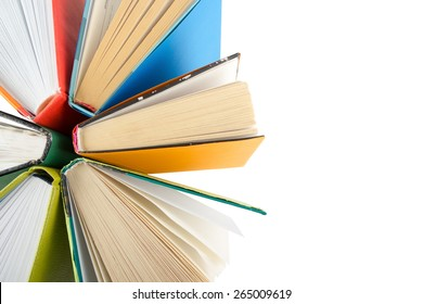 Top view of colorful hardback books in a circle isolated on white background. Back to school.