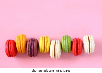 Top view of colorful macaron or macaroon on pink background. selective focus. Flat lay