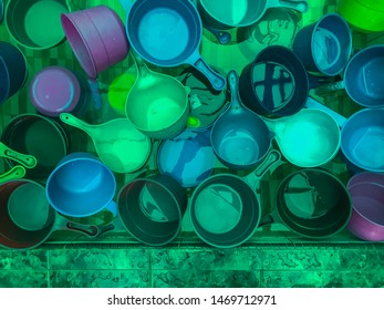 Top view of colorful plastic water dippers usually used by Muslims to scoop water for ablution (purification) before performing prayers.