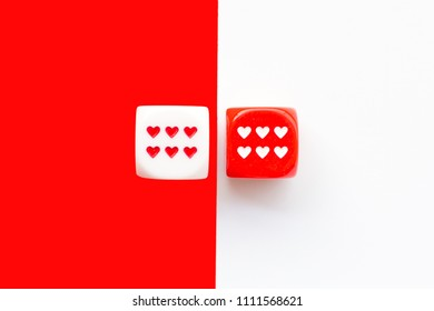 Top view of colorful rolling the dice concept for business risk, chance, good luck or gambling. White andred background. Love concept.