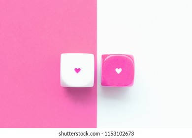 Top view of colorful rolling the dice concept for business risk, chance, good luck or gambling. White and pink background. Love concept.