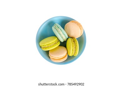 Top view of colorful tasty and yummy macarons served in plate, isolated on white background.