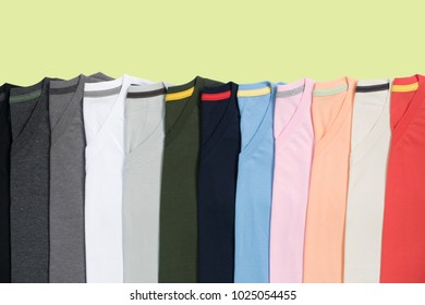 top view of colorful T-Shirt  with pastel background
