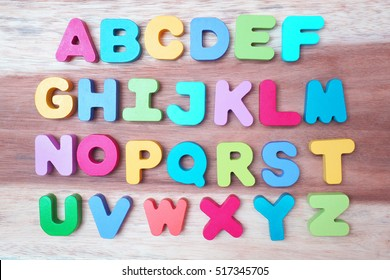 Top view colorful wooden letters A-Z sequentially on the wooden floor