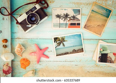 Top view composition - Summer photo album with starfish, shells, coral and items on wooden table. Concept of remembrance and nostalgia in summer tourism, travel and vacation. vintage color tone.