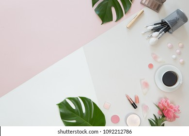 Top view concept of online shopping cosmetics on white and pink background flat lay, mock up and copyspace