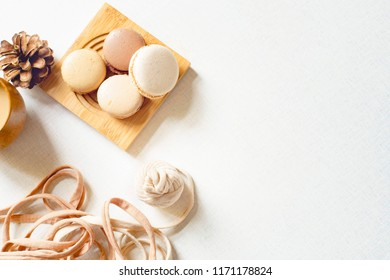 Top view of a cookie with latte and spruce cone and a yarn. Four cookie cakes, coffee and spruce cone and a tangle on the white table. Spring day. Flat lay with copy space for text.