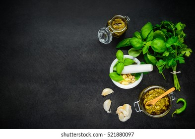 Top View of Copy Space Area with Pesto and Green Herbs with Pestle and Mortar