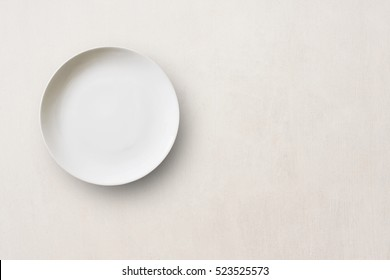 Top view with copy space white Empty plate on concrete floor background.