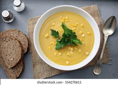 top view corn soup in ceramic bowl