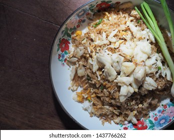Top view crab fried rice on wooden table.