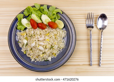 a top view of crab fried rice with fresh salad from an organic farm