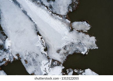 Top view of cracked ice in the river. Aerial photo.