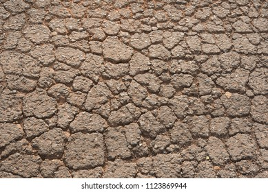 top view cracked red soil ground Earth for texture background,desert cracks,Dry Orange surface Arid,drought land,Picture of natural disaster. drought land Caused by global warming and deforestation
